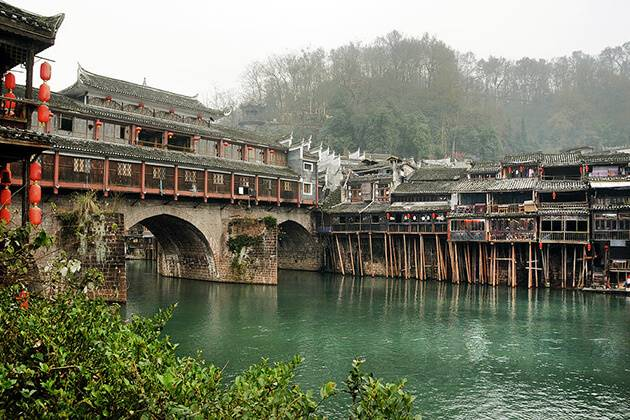 visitors of China Local Tour enjoy stunning view of Fenghuang Old town